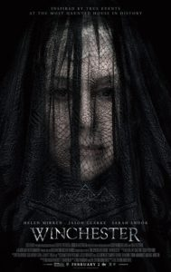 Film poster for Winchester. Image on poster is of Mrs. Winchester wearing a black mourning veil and staring straight ahead.