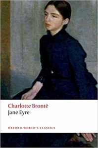 Book cover of Jane Eyre by Charlotte Bronte. It shows Jane sitting pensively against a plain background.