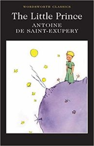 The Little Prince by Antoine de Saint-Exupéry book cover. Boy stands on asteroid looking at stars.