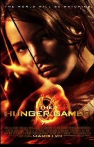 Jennifer Lawrence as Katniss Everdeen in the film poster for The Hunger Games. She is shooting an arrow straight ahead of her at whoever is looking at the poster.