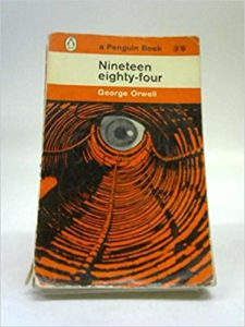Nineteen Eighty-Four by George Orwell book cover. Image is of an eye peering down a hole.