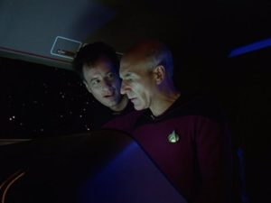 Patrick Stewart as Captain Picard and John de Lancie as Q