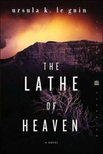 The Lathe of Heaven by Ursula K. Le Guin book cover. Photo shows a mountain and some scrub brush.
