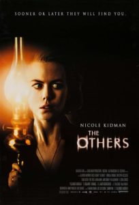Film poster for The Others. Image shows Nicole Kidman holding a glass lamp and staring off into the corner with a fearful expression on her face.