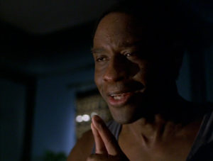 Tim Russ as Tuvok in Star Trek Voyager. Photo is of him suffering from pon farr. He is grimacing and his face is covered in perspiration.