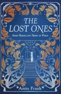 Book Cover for The Lost Ones by Anita Frank. Cover shows white outline of woman at top of staircase. There is a large picture window behind her and stylized leaves decorating the rest of the cover.