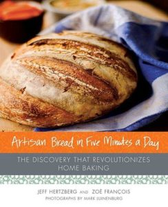 Artisan Bread in Five Minutes a Day: The Discovery That Revolutionizes Home Baking byJeff Hertzberg and  Zoë François book cover. Image on cover is of a freshly baked loaf of bread.