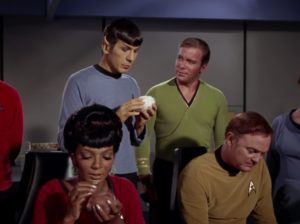 Leonard Nimoy as Mr. Spock. He and Uhura are holding tribbles while Captain Kirk (William Shatner) and Ensign Freeman (Paul Baxley) look on.