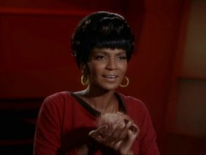 Nichelle Nichols as Uhura. She's holding a tribble.