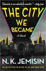 The City We Became by N.K. Jemisin book cover. Image on cover is of the underside of a bridge and the skyline of a large city.