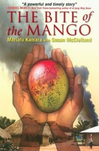 Book cover for The Bite of Mango by Mariatu Kamara and Susan McClelland. Image on the cover is of someone holding a mango in their hands.