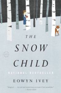 The Snow Child by Eowyn Ivey book cover. Image on cover is of a child hiding behind a tree on a snowy day.