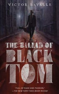 The Ballad of Black Tom by Victor LaValle book cover. Image on cover is of a man wearing a top hat and black cloak walking down a dark alley.