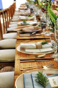 A wooden table set for a dinner party.