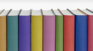 Books in assorted colours with blank spines.