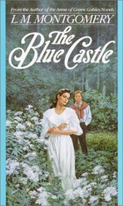 The Blue Castle by L.M. Montgomery book cover. Image on cover is of two lovers walking in a rose garden.
