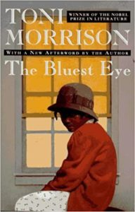 Book cover for The Bluest Eye by Toni Morrison. Image on cover is of african-american girl sitting by a window in the 1940s era.