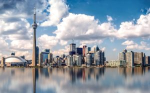 Toronto, Canada skyline. The famous CN Tower is one of the buildings in this shot. The foreground is of part of Lake Ontario