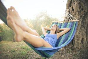 Woman relaxing in hammock outdoors