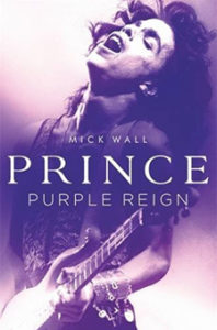 Prince- Purple Reign by Mick Wall book cover. Image on cover is of Prince playing a guitar and singing.