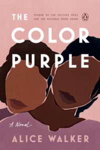 The Color Purple by Alice Walker book cover. Image on cover is of a drawing of two african american women. Their lips are drawn but not their eyes , noses or eyebrows