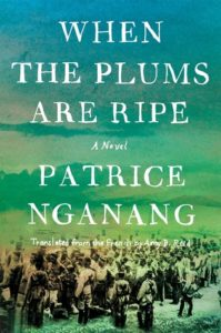 When the Plums Are Ripe by Patrice Nganang book cover. image on cover is a black-and-white photo of people walking on a dusty road