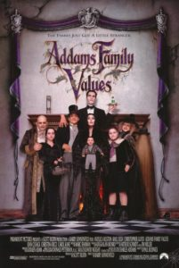 Film poster for Addams Family Values. Image on poster is of entire Addams family posing eerily and humorously in front of a large fireplace