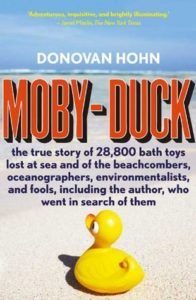 Moby-Duck by Donovan Hohn book cover. Image on cover is of a rubber duckie sitting on a patch of sand at the beach.