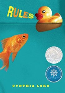 Rules by Cynthia Lord book cover. Image on cover is of a goldfish swimming in some water and looking at a rubber duckie floating on top of the water.