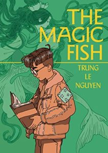 The Magic Fish by Trung Le Nguyen book cover. Image on cover is of boy reading a book and of mermaids swimming in the background.