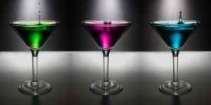 Three martinis. One green, one purple, and one blue.