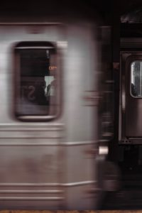 Blurry photo taken of a moving subway train