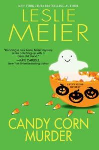 Candy Corn Murder (A Lucy Stone Mystery, #22) by Leslie Meier book cover. Image on cover is of a small ghost playfully peeking out of a bowl filled with candy corn