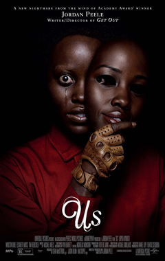 Film poster for Us. Image on poster is a photograph of one of the main characters holding a mask that is identical to their face. Their real face is crying.