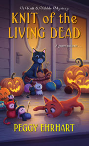 Knit of the Living Dead (A Knit & Nibble Mystery #6) by Peggy Ehrhart. Image on cover is of cartoon cats playfuly batting small knitted witch toys.
