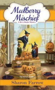 Mulberry Mischief (A Berry Basket Mystery #4) by Sharon Farrow book cover. Image on cover is of scarecrows dressed with jack-o-lantern heads and witch clothing.