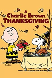 Poster for A Charlie Brown Thanksgiving. Image shows Charlie Brown and Snoopy standing next to table with a turkey and pie on it.