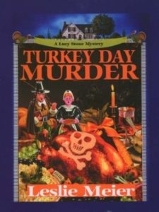 Turkey Day Murder (A Lucy Stone Mystery, #7) by Leslie Meier book cover. Image on cover is of two pilgrims looking shocked by a skull and crossbones that have been carved into a turkey.