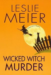 Wicked Witch Murder (A Lucy Stone Mystery, #16) by Leslie Meier book cover. Image on cover is of a witch flying past a full moon. There is a black cat on a fence below her.