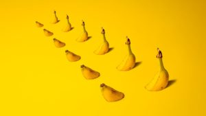 Bananas that are submerged in a bright yellow landscape.