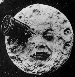 Screenshot from Le Voyage dans la lune (A Trip to the Moon) (1902) in which a rocket ship has wedged itself into the eye of the moon.