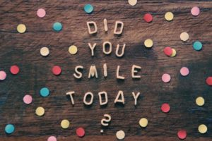 "Wooden sign with polka dots and the words ""did you smile today?"" written on it"