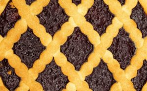 close-up photo of a fruit pie with a lattice crust