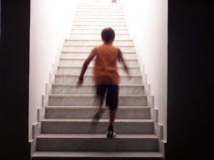 Child running up a flight of steps