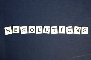 "scrabble bricks that spell out the word ""resolutions."""