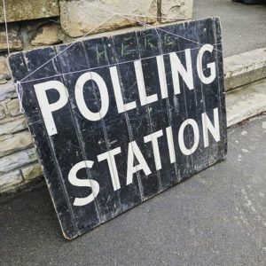 "Black and white sign that says ""polling station"""
