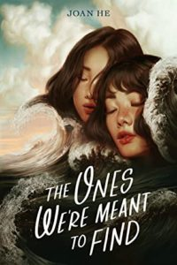 The Ones We're Meant to Find  by Joan He book cover. Image on cover shows two young woman closing their eyes and touching their heads together.