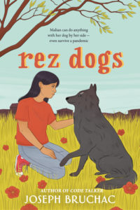 Rez Dogsby Joseph Bruchacbook cover. Image on cover is of a native child petting a dog in a field.