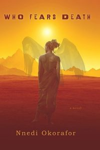 Who Fears Death (Who Fears Death, #1) by Nnedi Okorafor book cover. Image on cover shows a woman wearing dreadlocks and walking in the desert. There is a pair of wings superimposed on her body.