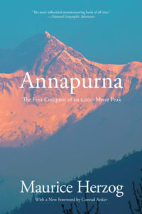 Annapurna- The First Conquest of an 8,000-Meter Peak by Maurice Herzog book cover. Image on cover shows sun setting on Annapurna mountain peak.